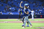 Canadian Olympian Penny Oleksiak throws out the ceremonial first pitch before the start of a baseball game between the Toronto Blue Jays and the Minnesota Twins in Toronto on Saturday, Sept. 18, 2021. (Jon Blacker/The Canadian Press via AP)