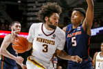 Minnesota's Jordan Murphy (3) drives around Illinois' Tevian Jones (5) during the first half of an NCAA college basketball game Wednesday, Jan. 30, 2019, in Minneapolis. (AP Photo/Bruce Kluckhohn)