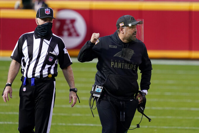 Carolina Panthers head coach Matt Rhule gestures next to an official during the first half of an NFL football game between the Kansas City Chiefs and the Panthers in Kansas City, Mo., Sunday, Nov. 8, 2020. (AP Photo/Jeff Roberson)