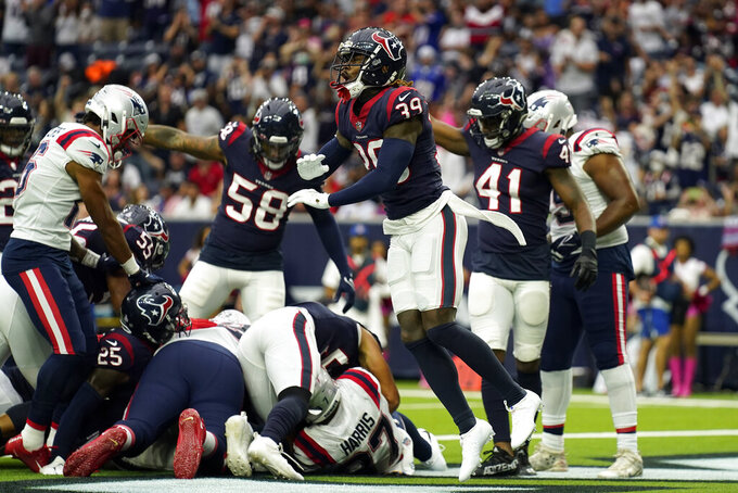 Houston Texans cornerback Terrance Mitchell (39) celebrates after forcing a fumble by New England Patriots' Damien Harris at the goal line during the first half of an NFL football game Sunday, Oct. 10, 2021, in Houston. The Texans recovered the fumble. (AP Photo/Eric Christian Smith)