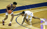 Washington's Nate Roberts, right, stumbles and loses his defensive posture on Montana's Kyle Owens in the first half of an NCAA college basketball game, Wednesday, Dec. 16, 2020, at Alaska Airlines Arena in Seattle. (Dean Rutz/The Seattle Times via AP)