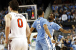 North Carolina forward Garrison Brooks (15) and guard Brandon Robinson (4) react during the second half of an NCAA college basketball game against Virginia Tech at the Atlantic Coast Conference tournament in Greensboro, N.C., Tuesday, March 10, 2020. (AP Photo/Gerry Broome)