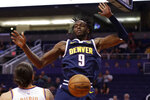 Denver Nuggets forward Jerami Grant (9) dunks against the Phoenix Suns during the first half of an NBA preseason basketball game, Monday, Oct. 14, 2019, in Phoenix. (AP Photo/Matt York)