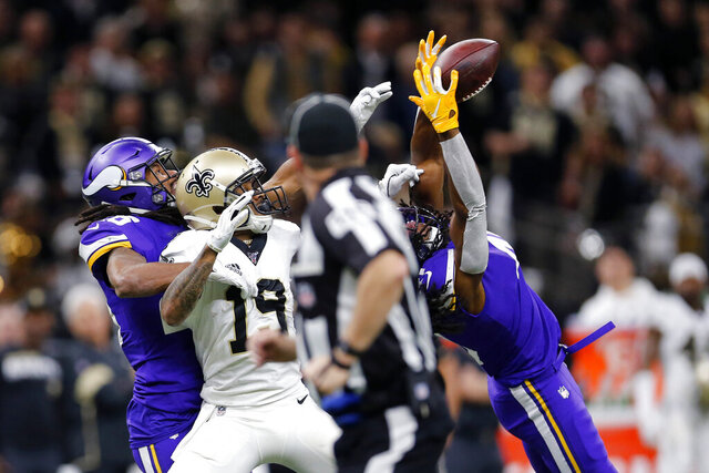 Minnesota Vikings defensive back Anthony Harris intercepts a pass intended for New Orleans Saints wide receiver Ted Ginn (19) in the first half of an NFL wild-card playoff football game, Sunday, Jan. 5, 2020, in New Orleans. (AP Photo/Brett Duke)