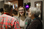 Abigail Bessler, center, daughter of Democratic presidential candidate Sen. Amy Klobuchar, D-Minn., talks to members of the Montgomery Co. Democrats during a campaign gathering Tuesday, Jan. 21, 2020, in Stanton, Iowa. (AP Photo/Marcio Jose Sanchez)