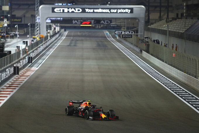 Red Bull driver Max Verstappen of the Netherlands wins the Formula One race in the Yas Marina racetrack in Abu Dhabi, United Arab Emirates, Sunday, Dec.13, 2020. (Brynn Lennon, Pool via AP)