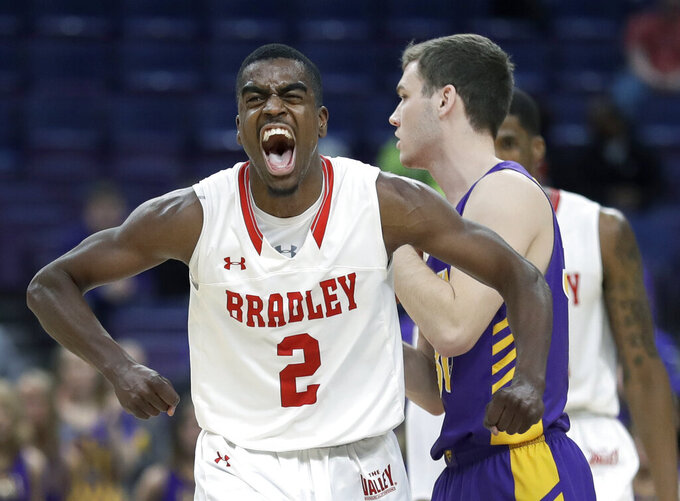 Bradley's Luqman Lundy (2) celebrates after making a basket as Northern Iowa's Spencer Haldeman, right, walks behind during the second half of an NCAA college basketball game in the championship of the Missouri Valley Conference tournament, Sunday, March 10, 2019, in St. Louis. Bradley won 57-54. (AP Photo/Jeff Roberson)