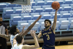 Notre Dame guard Prentiss Hubb (3) drives to the basket while North Carolina forward Walker Kessler and guard Kerwin Walton defend during the second half of an NCAA college basketball game in Chapel Hill, N.C., Saturday, Jan. 2, 2021. (AP Photo/Gerry Broome)