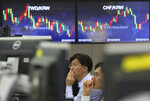 Currency traders watch monitors at the foreign exchange dealing room of the KEB Hana Bank headquarters in Seoul, South Korea, Friday, Oct. 12, 2018. Asian stocks were mixed on Friday as better-than-expected Chinese trade data gave some markets a breather from worries about the impact of punitive tariffs.(AP Photo/Ahn Young-joon)