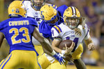 LSU quarterback Max Johnson (14) is tackled by McNeese State defensive lineman C.J. Semien (96) during the first half of an NCAA college football game in Baton Rouge, La., Saturday, Sept. 11, 2021. (AP Photo/Matthew Hinton)