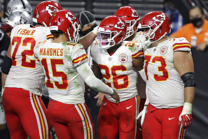 Kansas City Chiefs celebrate after running back Le'Veon Bell (26) scored a touchdown against the Las Vegas Raiders during the second half of an NFL football game, Sunday, Nov. 22, 2020, in Las Vegas. (AP Photo/Isaac Brekken)
