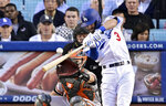 Los Angeles Dodgers' Chris Taylor hits a three-run home run as San Francisco Giants catcher Buster Posey and home plate umpire Carlos Torres watch during the first inning of a baseball game Wednesday, June 19, 2019, in Los Angeles. (AP Photo/Mark J. Terrill)
