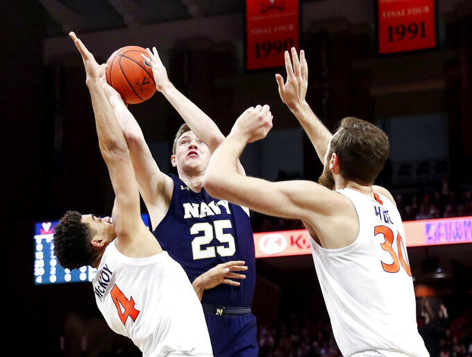Navy forward Alec Loehr (25) is pressured by Virginia forwards Justin McKoy (4) and Jay Huff (30) during an NCAA college basketball game in Charlottesville, Va., Sunday, Dec. 29, 2019. (AP Photo/Andrew Shurtleff)