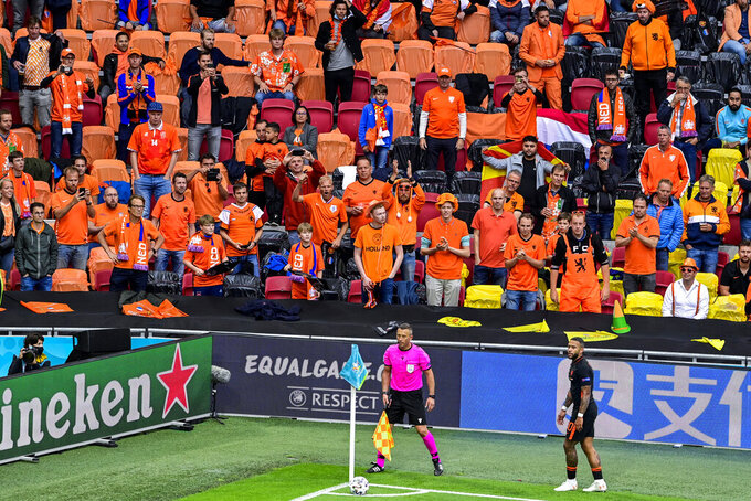 Memphis Depay of the Netherlands prepares to take a corner kick during the Euro 2020 soccer championship group C match between The Netherlands and North Macedonia at the Johan Cruyff ArenA in Amsterdam, Netherlands, Monday, June 21, 2021. (Olaf Kraak, Pool via AP)