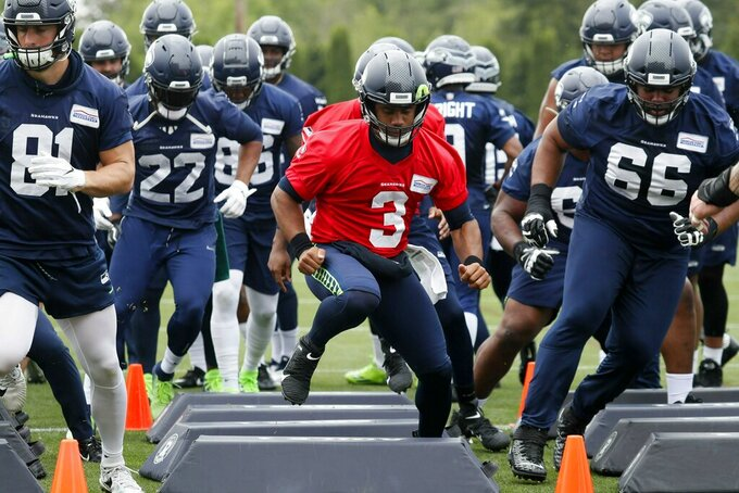 Seattle Seahawks quarterback Russell Wilson (3) runs a drill during an NFL football practice, Wednesday, May 29, 2019 in Renton, Wash. (Erika Schultz/The Seattle Times via AP)