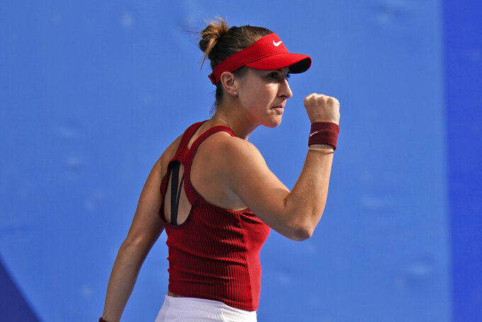 Belinda Bencic, of Switzerland, reacts after winning a set against Elena Rybakina, of Kazakhstan, during the semifinals of the tennis competition at the 2020 Summer Olympics, Thursday, July 29, 2021, in Tokyo, Japan. (AP Photo/Seth Wenig)
