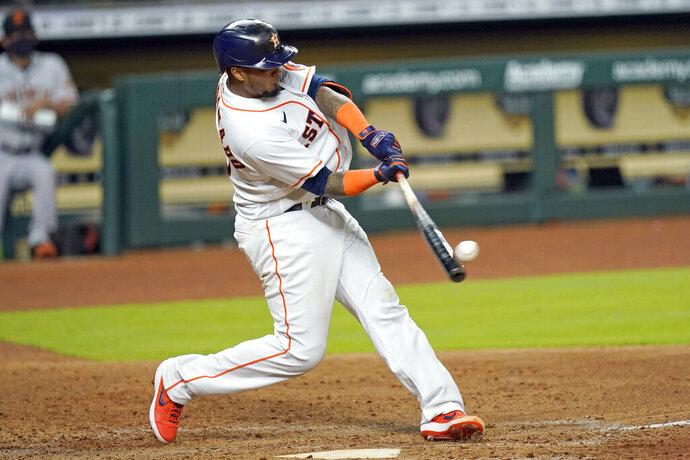 Houston Astros' Martin Maldonado hits a three-run home run against the San Francisco Giants during the sixth inning of a baseball game Wednesday, Aug. 12, 2020, in Houston. (AP Photo/David J. Phillip)