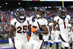 Denver Broncos' Melvin Gordon (25) celebrates with Javonte Williams (33) and K.J. Hamler (1) after scoring a touchdown during the second half of an NFL football game Sunday, Sept. 12, 2021, in East Rutherford, N.J. The Broncos won 27-13. (AP Photo/Adam Hunger)