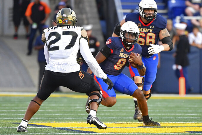 Navy quarterback Maasai Maynor (9) runs the ball against Air Force linebacker TD Blackmon (27) during the second half of an NCAA college football game, Saturday, Sept. 11, 2021, in Annapolis, Md. (AP Photo/Terrance Williams)
