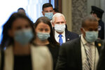 Vice President Mike Pence wears a face mask to protect against the spread of the new coronavirus as he arrives on Capitol Hill in Washington for a meeting with Senate Majority Leader Mitch McConnell of Ky., and Treasury Secretary Steve Mnuchin, Tuesday, May 19, 2020. (AP Photo/Patrick Semansky)