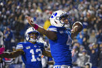 BYU running back Lopini Katoa (4) celebrates a touchdown during the first half of the team's NCAA college football game against Boise State on Saturday, Oct. 19, 2019, in Provo, Utah. (AP Photo/Tyler Tate)