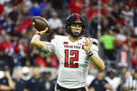 Texas Tech quarterback Tyler Shough (12) throws the ball against Houston during the first half of an NCAA college football game Saturday, Sept. 4, 2021, in Houston. (AP Photo/Justin Rex)