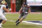 Arizona quarterback Will Plummer (15) runs for a first down against Colorado during the first half of an NCAA college football game, Saturday, Dec. 5, 2020, in Tucson, Ariz. (AP Photo/Rick Scuteri)