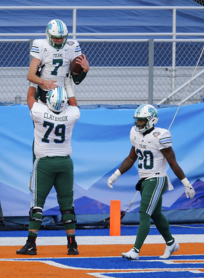Tulane offensive lineman Joey Claybrook (79) lifts quarterback Michael Pratt (7) after Pratt's touchdown run during the second half against Nevada in the Famous Idaho Potato Bowl NCAA college football game, Tuesday, Dec. 22, 2020, in Boise, Idaho. Nevada won 38-27. (AP Photo/Steve Conner)