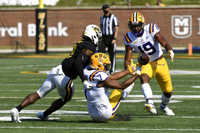LSU safety JaCoby Stevens (7) is unable to intercept a pass intended for Missouri wide receiver Jalen Knox, left, as LSU's Jabril Cox (19) watches during the first half of an NCAA college football game Saturday, Oct. 10, 2020, in Columbia, Mo. (AP Photo/L.G. Patterson)