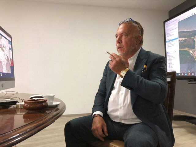 In this April 29, 2020 photo, Venezuelan shipping magnate Wilmer Ruperti smokes a cigarette during an interview in Caracas, Venezuela. As a result of U.S. sanctions on Venezuela, a high-stakes legal fight in U.S. federal court is pitting Ruperti against Greek shipping magnate Evangelos Marinakis, in connection with oil tanker Alkimos carrying high octane gasoline estimated to be worth millions. (AP Photo/Scott Smith)