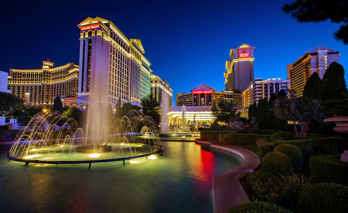 FILE - This June 23, 2019, file photo shows Caesars Palace in Las Vegas. Casino company Eldorado Resorts Inc. says it is selling two of its 28 properties and will use the proceeds to help it buy Caesars Entertainment Corp. Reno-based Eldorado announced Thursday, July 11, 2019, that Rhode Island-based Twin River Worldwide Holdings Inc. will buy the Lady Luck Casino in Vicksburg, Mississippi, and the Isle of Capri property in Kansas City, Missouri, for a combined $230 million. (L.E. Baskow/Las Vegas Review-Journal via AP, File)