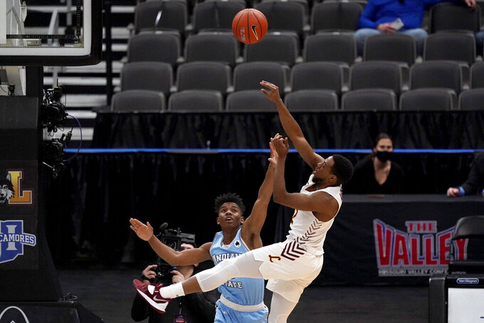 Loyola of Chicago's Marquise Kennedy, right, shoots as Indiana State's Julian Larry defends during the first half of an NCAA college basketball game in the semifinal round of the Missouri Valley Conference men's tournament Saturday, March 6, 2021, in St. Louis. (AP Photo/Jeff Roberson)