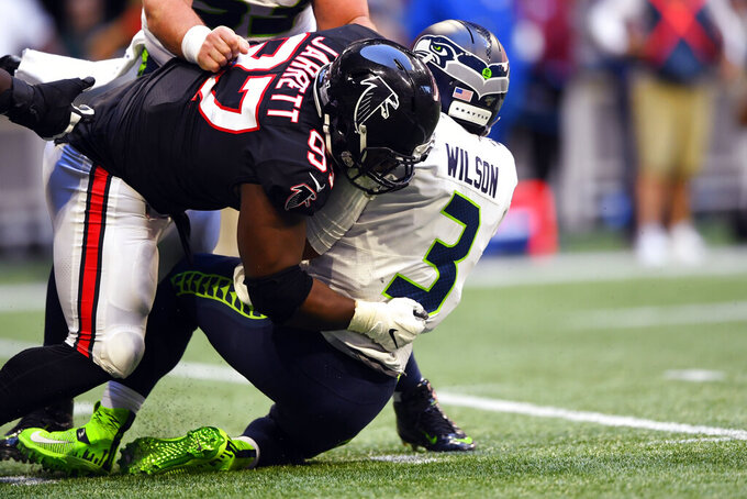 Atlanta Falcons defensive tackle Grady Jarrett (97) sacks Seattle Seahawks quarterback Russell Wilson (3) during the second half of an NFL football game, Sunday, Oct. 27, 2019, in Atlanta. (AP Photo/John Amis)