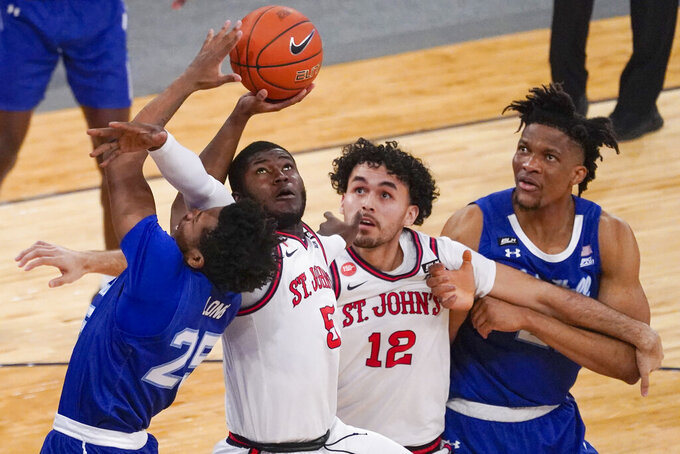 St. John's guard Dylan Addae-Wusu (5) stops Seton Hall guard Jahari Long (25) from scoring during the first half of an NCAA college basketball game in the quarterfinals of the Big East conference tournament, Thursday, March 11, 2021, in New York. (AP Photo/Mary Altaffer)