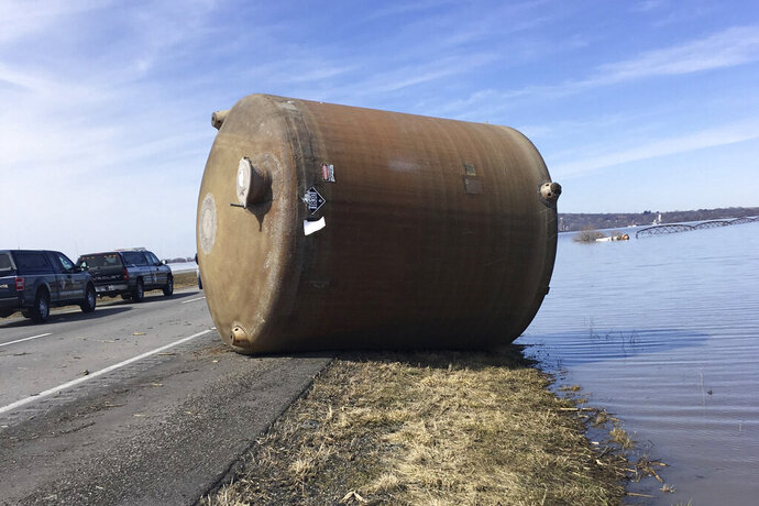 This photo provided by the Missouri Department of Natural Resources taken in Boone County, Mo. in March 2019 shows one of hundreds of containers — many carrying hazardous materials — that have floated into Missouri since flooding in the upper Missouri River basin during the spring. (Missouri Department of Natural Resources via AP)