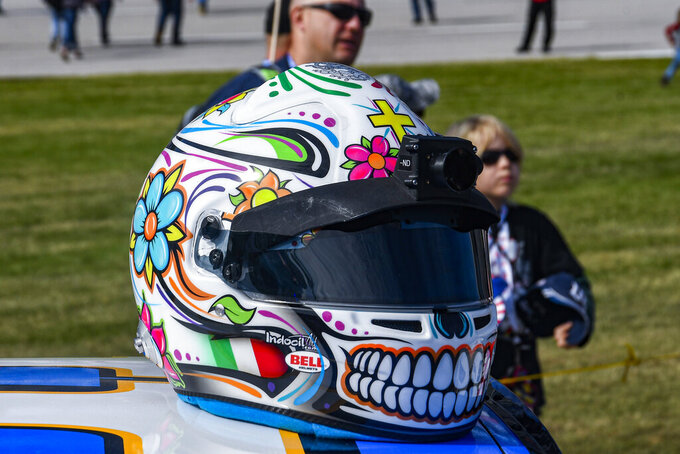 "Daniel Suarez's helmet featured a ""sugar skull"" in celebration of the ""Dia de los Muertos, or Day of the Dead"" during a NASCAR Cup Series auto race at Texas Motor Speedway, Sunday, Nov. 3, 2019, in Fort Worth, Texas. (AP Photo/Randy Holt)"