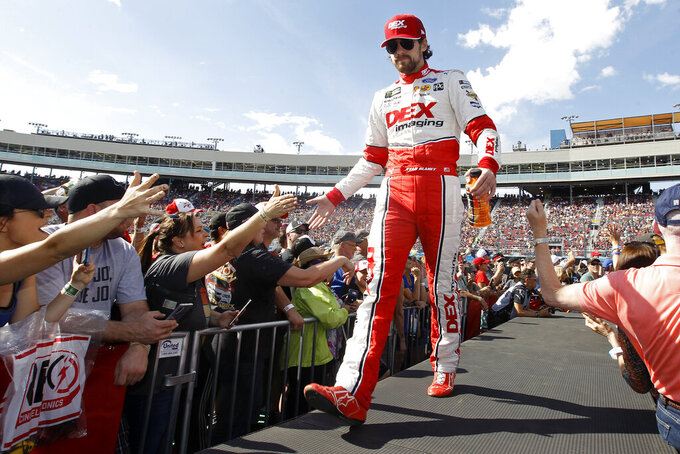 Ryan Blaney greets fans during driver introductions prior to the NASCAR Cup Series auto race at ISM Raceway, Sunday, Nov. 10, 2019, in Avondale, Ariz. (AP Photo/Ralph Freso)