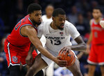 St. John's guard LJ Figueroa, left, knocks the ball from the hands of Xavier forward Naji Marshall (13) during the second half of an NCAA college basketball game, Sunday, Jan. 5, 2020, in Cincinnati. (AP Photo/Gary Landers)