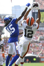 Cleveland Browns wide receiver KhaDarel Hodge (12) catches a 7-yard touchdown pass against New York Giants cornerback Madre Harper (45) during the first half of an NFL football game, Sunday, Aug. 22, 2021, in Cleveland. (AP Photo/David Dermer)