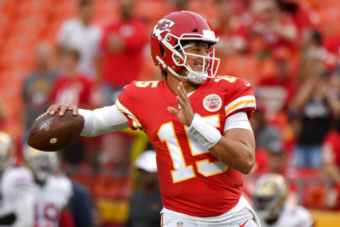 Kansas City Chiefs quarterback Patrick Mahomes (15) warms up before an NFL preseason football game against the San Francisco 49ers in Kansas City, Mo., Saturday, Aug. 24, 2019. (AP Photo/Ed Zurga)