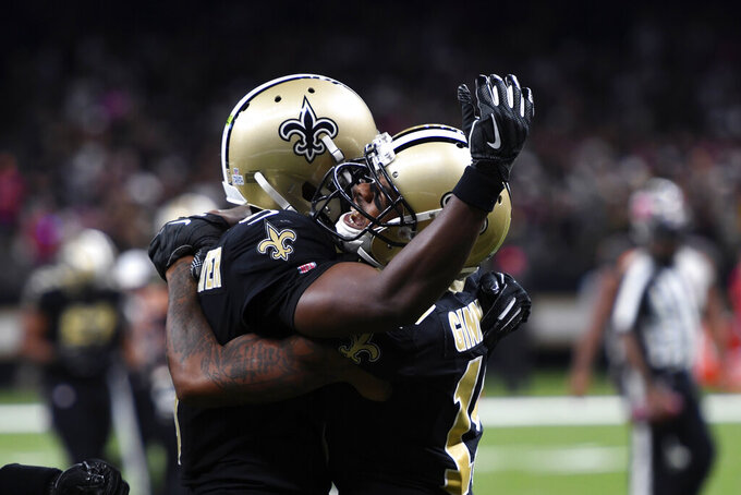 New Orleans Saints wide receiver Ted Ginn, right, celebrates his touchdown reception with quarterback Teddy Bridgewater in the second half of an NFL football game against the Tampa Bay Buccaneers in New Orleans, Sunday, Oct. 6, 2019. (AP Photo/Bill Feig)