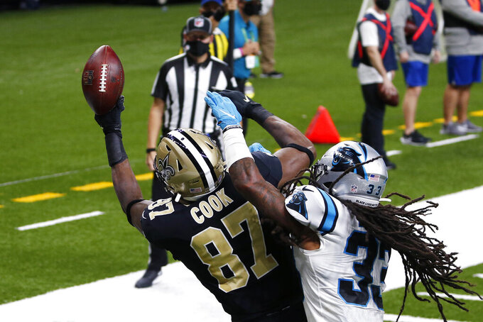 New Orleans Saints tight end Jared Cook (87) pulls in a touchdown reception ain't Carolina Panthers free safety Tre Boston (33) in the first half of an NFL football game in New Orleans, Sunday, Oct. 25, 2020. (AP Photo/Butch Dill)