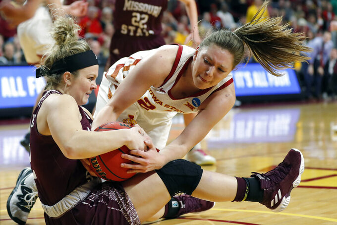 FILE - In this March 25, 2019, file photo, Missouri State guard Elle Ruffridge, left, and Iowa State guard Ashley Joens, right, fight over a loose ball during the first half of a second-round game in the NCAA women's college basketball tournament in Ames, Iowa. Joens, a 6-foot guard from Iowa City, scored the final four points in a 63-59 win over Oklahoma on Feb. 8 , 2020, after dislocating her shoulder. Joens consistently draws the opponent's top defender, sometimes more than one. One of the Big 12's best all-around players always comes out smiling after wincing. (AP Photo/Matthew Putney, File)