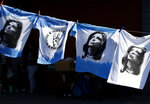 FILE - This Sept. 21, 2019 file photo shows T-shirts emblazoned with an image of former President Cristina Fernandez displayed for sale in Buenos Aires, Argentina. Fernandez is now running as vice president in a ticket that is likely to beat Argentina's current President Mauricio Macri, who won his first term with the support of the key farming sector. (AP Photo/Natacha Pisarenko, File)