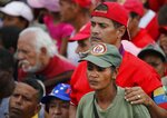 Supporters listen Venezuela's President Nicolas Maduro at a rally in Caracas, Venezuela, Saturday, Feb. 2, 2019. Maduro called the rally to celebrate the 20th anniversary of the late President Hugo Chavez's rise to power. (AP Photo/Ariana Cubillos)