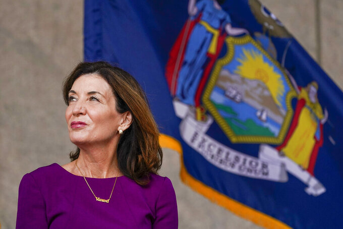 """New York Gov. Kathy Hochul wears a necklace with the word """"vaxed"""" during an event in the Harlem neighborhood of New York, Thursday, Aug. 26, 2021. Hochul has selected Brian Benjamin, a state senator from New York City, as her choice for lieutenant governor. (AP Photo/Mary Altaffer)"""