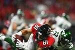 Atlanta Falcons tight end Austin Hooper (81) makes the catch against New York Jets strong safety Jamal Adams (33) during the first half an NFL preseason football game, Thursday, Aug. 15, 2019, in Atlanta. (AP Photo/John Amis)
