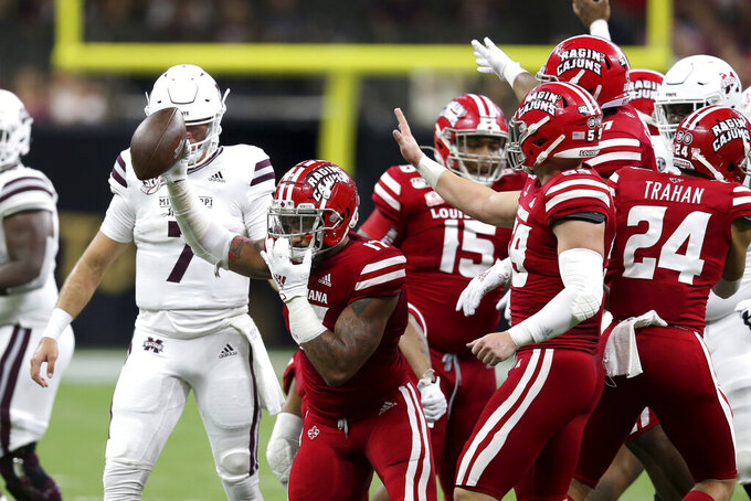 Louisiana-Lafayette linebacker Chauncey Manac (17) celebrates after recovering a fumble by Mississippi State quarterback Tommy Stevens (7) in the first half of an NCAA college football game in New Orleans, Saturday, Aug. 31, 2019. (AP Photo/Chuck Cook)