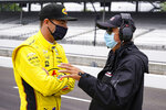 Scott McLaughlin, of New Zealand, talks with four-time Indianapolis 500 champion Rick Mears before the start of the final practice for the Indianapolis 500 auto race at Indianapolis Motor Speedway in Indianapolis, Friday, May 28, 2021. (AP Photo/Michael Conroy)