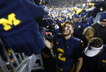 Michigan quarterback Shea Patterson (2) celebrates on the way to the locker room after beating Indiana 31-20 in an NCAA college football game in Ann Arbor, Mich., Saturday, Nov. 17, 2018. (AP Photo/Paul Sancya)